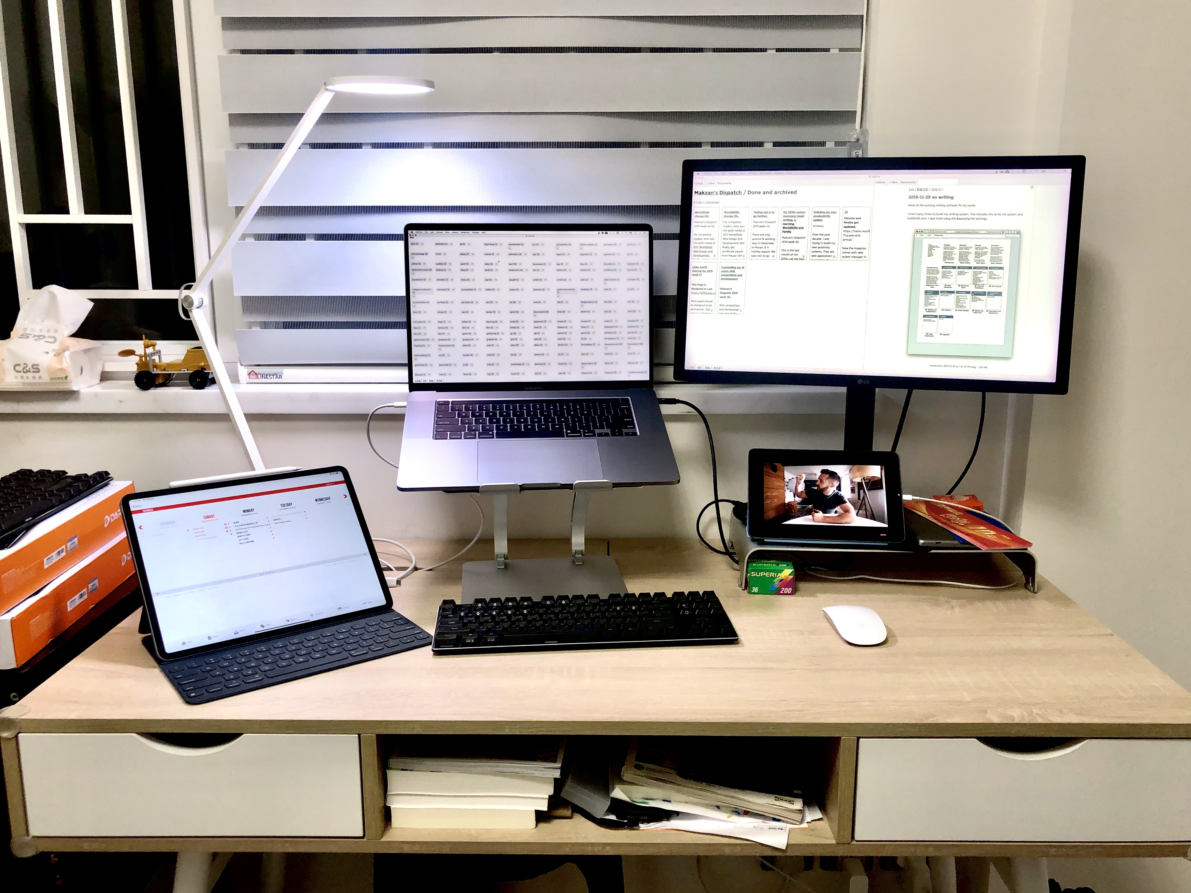 Upgraded my home workspace setup with a notebook stand.